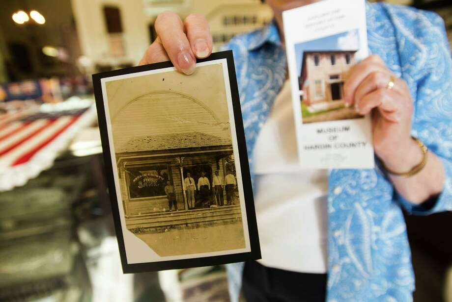 Renee Wells shows off a photo of a bank building that would later become the Museum of Hardin County. Area natives Renee and Cecil Wells oversee the museum in Kountze.    Photo taken Wednesday 7/22/15  Jake Daniels/The Enterprise Photo: Jake Daniels / ©2015 The Beaumont Enterprise/Jake Daniels