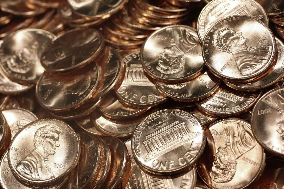 Recently struck pennies sit in a bin at the U.S. Mint in Philadelphia. A reader agrees with a recent E-N editorial that indicated it is time to get rid of the penny. Photo: STEPHEN HILGER /BLOOMBERG NEWS