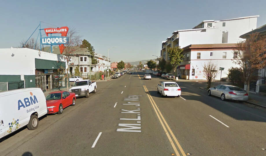 A rifle-wielding suspect was killed and an Oakland police officer was wounded an gunfire exchange early Monday on the 3800 block of Martin Luther King Jr. Way near Apgar Street. Photo: Google Maps