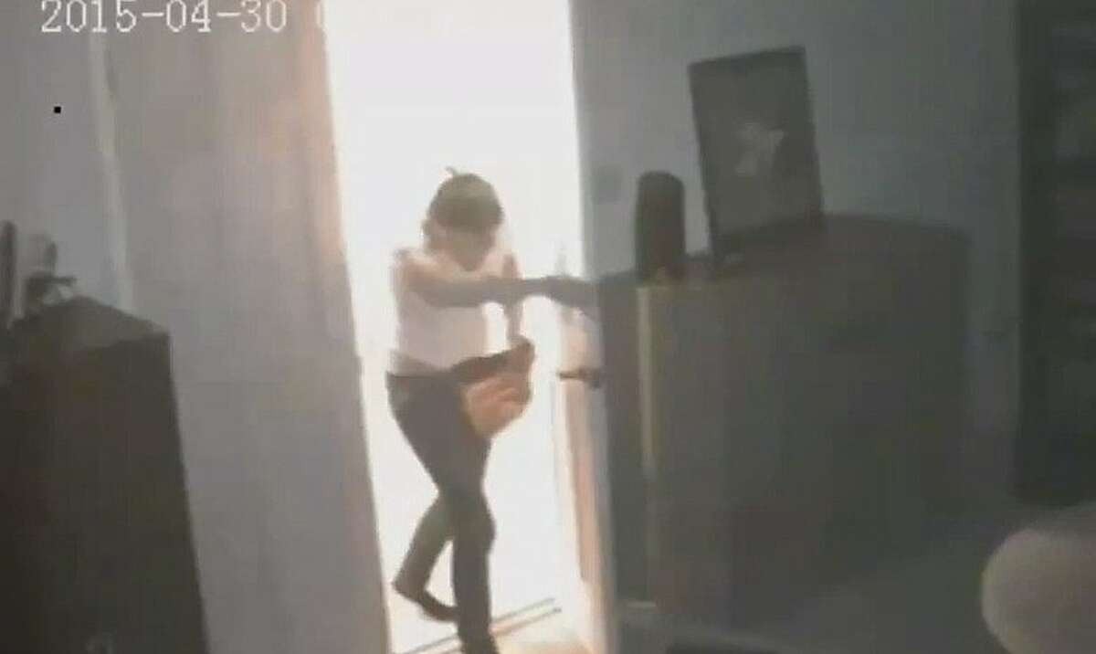 Police released security video of a suspect ransacking a home rented through Airbnb.