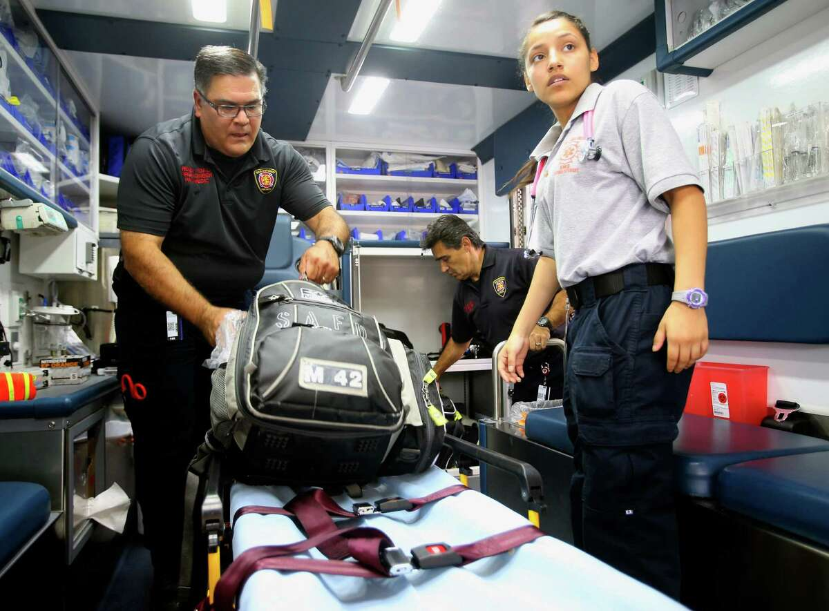 Edison High School student Gisel Garcia, a student in the fire sciences magnet program, helped a San Antonio Fire Department EMT crew Tuesday as they did their daily check of equipment on their ambulance.