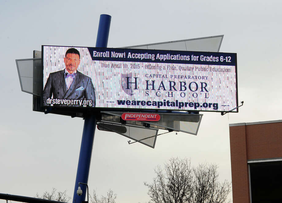 A digital billboard displays an add to enroll in Harbor School near Main Street in Bridgeport, Conn., on Friday Mar. 27, 2015. Photo: Christian Abraham / Christian Abraham / Connecticut Post