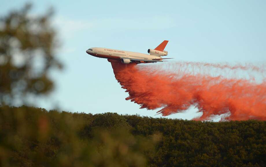 An air tanker drops fire retardant along a ridge to help contain the Rocky fire near Clearlake, California on August 2, 2015.  Photo: Josh Edelson, AFP / Getty Images