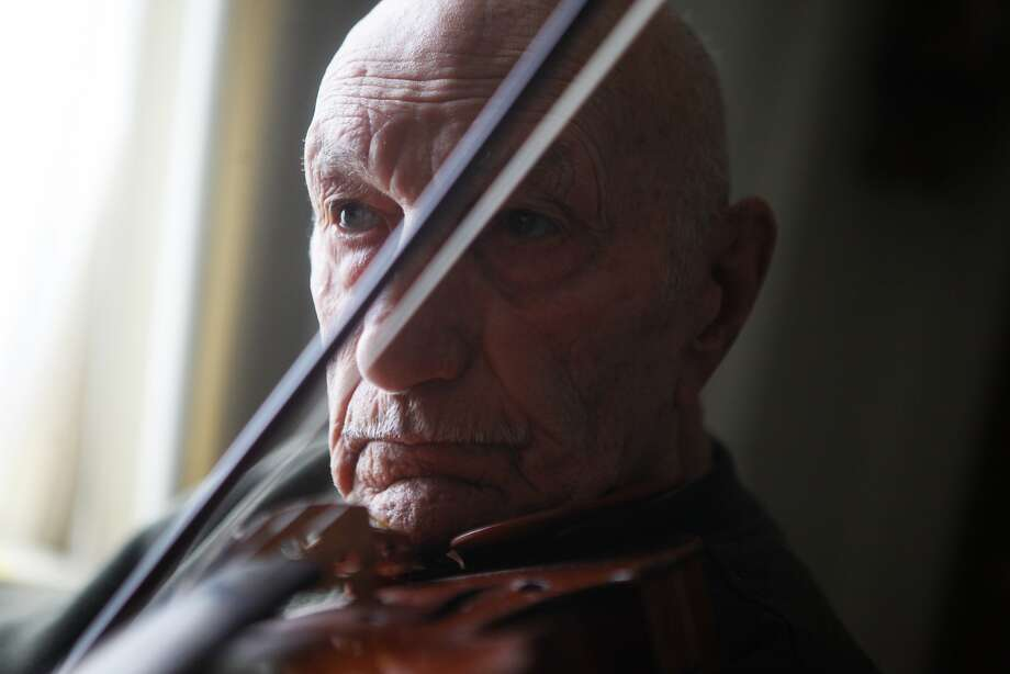 Remo del Tredici practices the violin inside his practice room in his home on July 31, 2015. Photo: Cameron Robert, The Chronicle