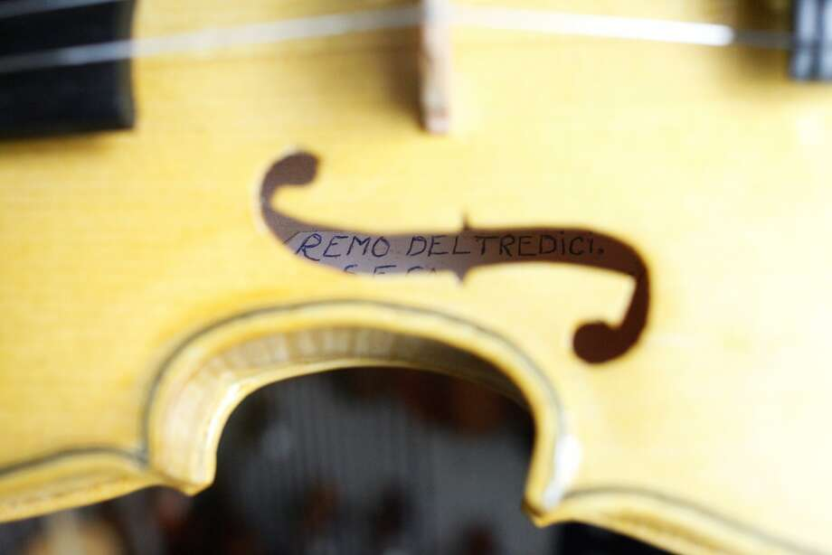 Within each violin Remo del Tredici makes he signs his name. Photo: Cameron Robert, The Chronicle