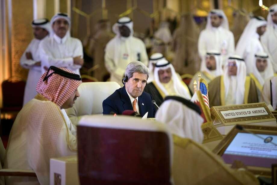 U.S. Secretary of State John Kerry (center) meets with his Gulf Arab counterparts in Doha, Qatar. Photo: Brendan Smialowski, Associated Press