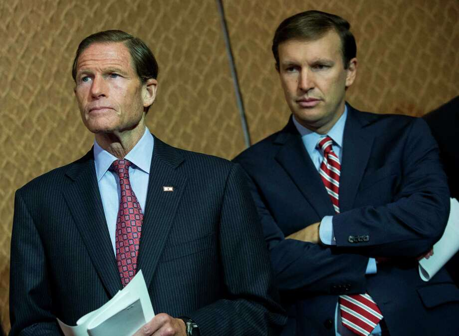 """Sens. Richard Blumenthal, left, and Chris Murphy, D-Conn.,wait tospeak during an event hosted by """"Everytown for Gun Safety"""" and """"Moms Demand Action for Gun Sense in America"""" in July in Washington, DC. Both groups hosting the event are urging Congress to discuss potential legislation to expand background checks on gun sales. Photo: Drew Angerer / Getty Images / 2015  Getty Images"""