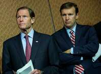 """Sens. Richard Blumenthal, left, and Chris Murphy, D-Conn.,wait tospeak during an event hosted by """"Everytown for Gun Safety"""" and """"Moms Demand Action for Gun Sense in America"""" in July in Washington, DC. Both groups hosting the event are urging Congress to discuss potential legislation to expand background checks on gun sales."""