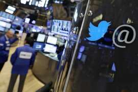 FILE - In this Tuesday, July 28, 2015, file photo, the logo for Twitter adorns a phone post on the floor of the New York Stock Exchange. The last week of July 2015 hasn't been an easy week for social media stocks, despite double-digit revenue growth from Twitter, LinkedIn and Facebook. Investors are looking beyond headline earnings numbers to find reasons to sell stock. (AP Photo/Richard Drew, File)