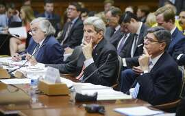 WASHINGTON, DC - JULY 28: U.S. Secretary of State John Kerry, Secretary of Energy, Dr. Ernest Moniz (L) and Secretary of the Treasury Jacob Lew (R)  look on at a hearing before the House Foreign Affairs Committee July 28, 2015 on Capitol Hill in Washington, DC. The committee is reviewing the proposed Iran nuclear agreement.(Photo by Olivier Douliery/Getty Images)