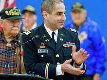 Thomas Saadi, Major U.S. Army Reserves, applauds the veterans as he hosted Pearl Harbor Memorial Service in the War Memorial Building at Rogers Park. Sunday, Dec. 7, 2014. Saadi is on the organizing committee for the Danbury Council of Veterans' World War II 70th Anniversary and Remembrance Ceremony, organized by the Catholic War Veterans Post 1042.