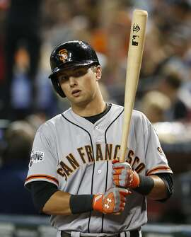 The Giants will wait a couple of days before getting injured second baseman Joe Panik into a minor-league game. (AP Photo/Rick Scuteri)