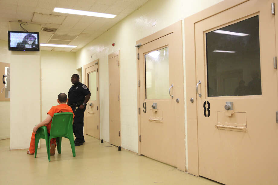 This file photo shows a deputy watchings over inmates in the Suicide Prevention Unit of the Bexar County Jail in 2012. Although Bexar County updated procedures a few years ago, Sandra Bland's death in Waller County again has put the spotlight on the issue in Texas. Photo: JERRY LARA /San Antonio Express-News / © 2012 San Antonio Express-News