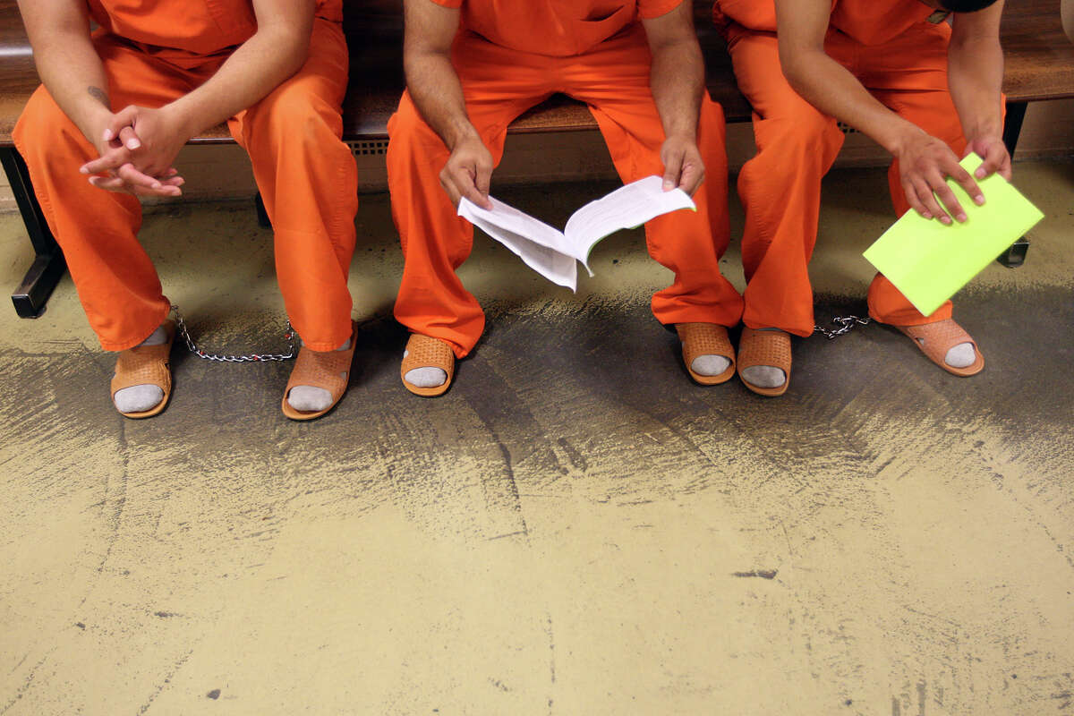 Inmates wait their turn at the intake area of the Bexar County Jail.