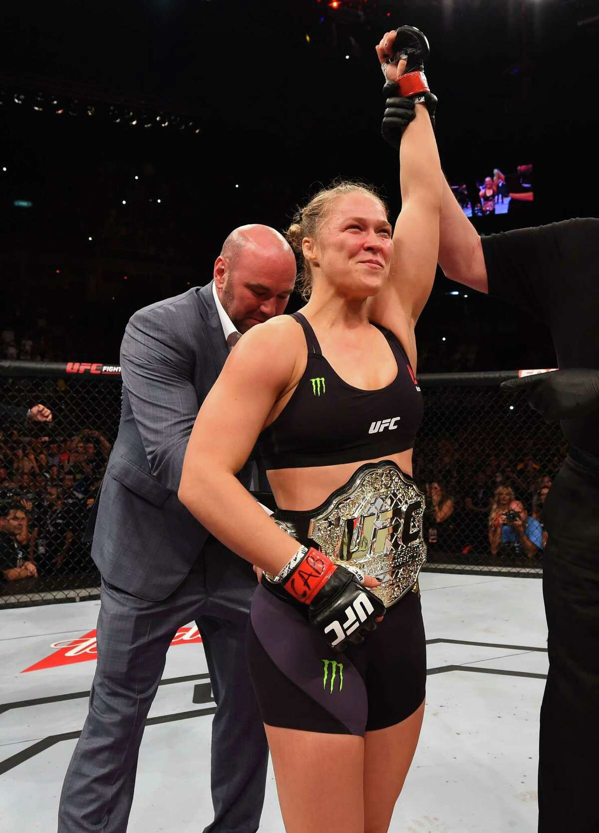 RIO DE JANEIRO, BRAZIL - AUGUST 01: Ronda Rousey of the United States celebrates her knock out victory over Bethe Correia of Brazil in the first round in their UFC women's bantamweight championship bout during the UFC 190 event inside HSBC Arena on August 1, 2015 in Rio de Janeiro, Brazil.