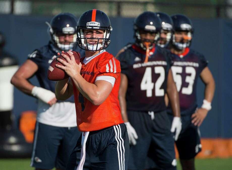 UTSA quarterback Blake Bogenschutz looks to pass during football practice, Monday, Aug. 3, 2015, at UTSA in San Antonio. Photo: Darren Abate /For The Express-News / San Antonio Express-News