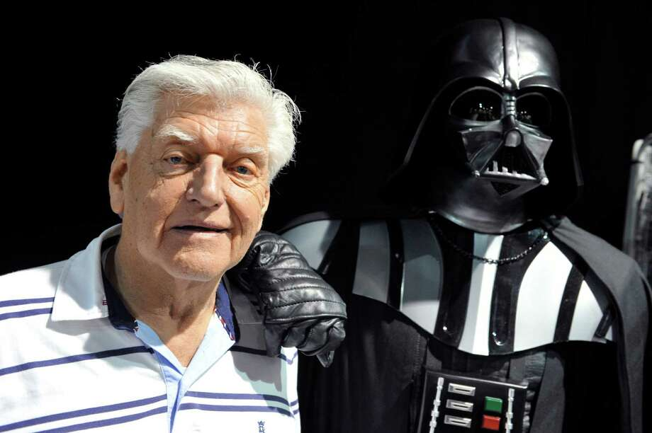 """English actor David Prowse (L), who played the character of Darth Vader in the first """"Star Wars"""" trilogy poses with a fan dressed up in a Darth Vader costume during a Star Wars convention on April 27, 2013 in Cusset. AFP PHOTO THIERRY ZOCCOLAN (Photo credit should read THIERRY ZOCCOLAN/AFP/Getty Images) English actor David Prowse (L), who played the character of Darth Vader (Dark Vador in French) in the first Star Wars trilogy poses with a fan dressed up in a Darth Vader costume during a Star Wars convention on April 27, 2013 in Cusset. AFP PHOTO THIERRY ZOCCOLAN (Photo credit should read THIERRY ZOCCOLAN/AFP/Getty Images) Photo: THIERRY ZOCCOLAN /AFP /Getty Images / 2013 AFP"""