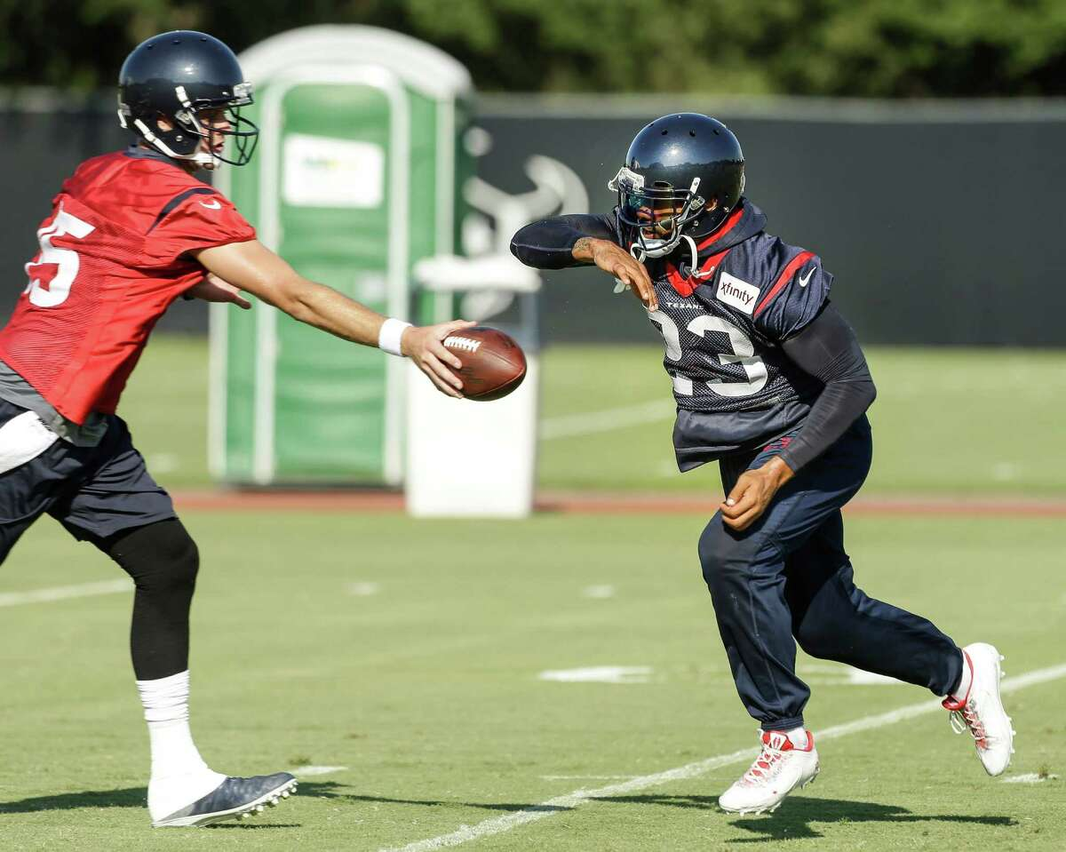 Arian Foster, right, may be somewhat old in running back years (he turns 29 later this month and has nearly 1,400 career carries), but he has had a spring in his step during training camp.