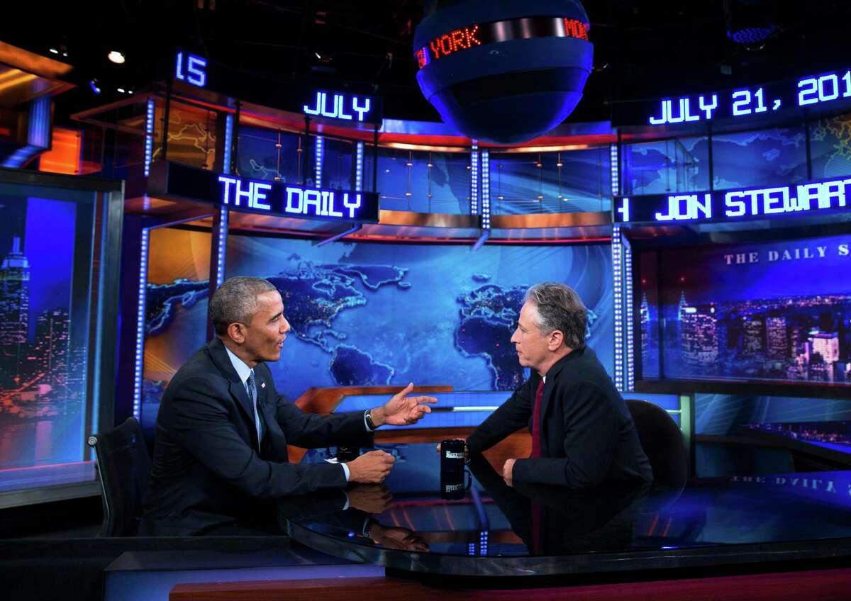 President Barack Obama (left) talks with Jon Stewart, host of