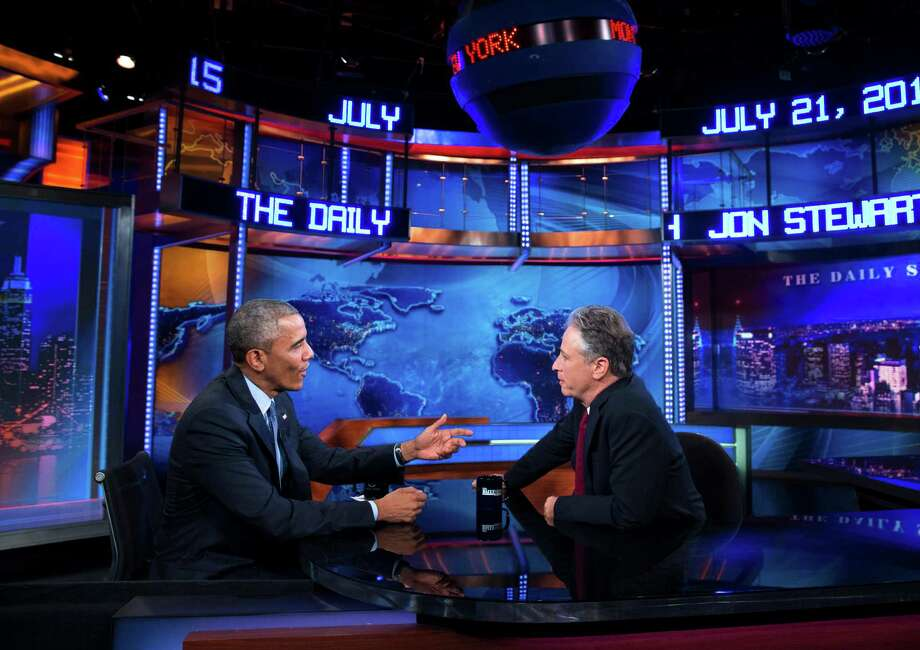 "President Barack Obama (left) talks with Jon Stewart, host of ""The Daily Show with Jon Stewart"" in January. Photo: Evan Vucci /Associated Press / AP"