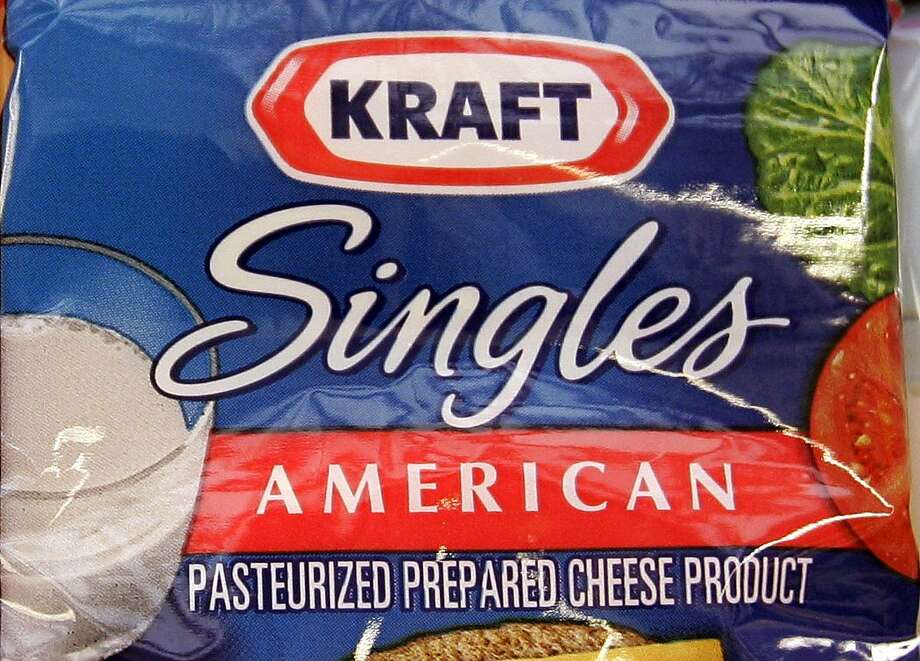 Kraft is warning that some packaging can cling to cheese slices, posing a health risk. Photo: Paul Sakuma, Associated Press