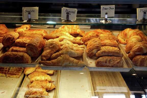 A display case with bakery items at Parisian Bakery which serves Vietnamese pastries, sandwiches and drinks.