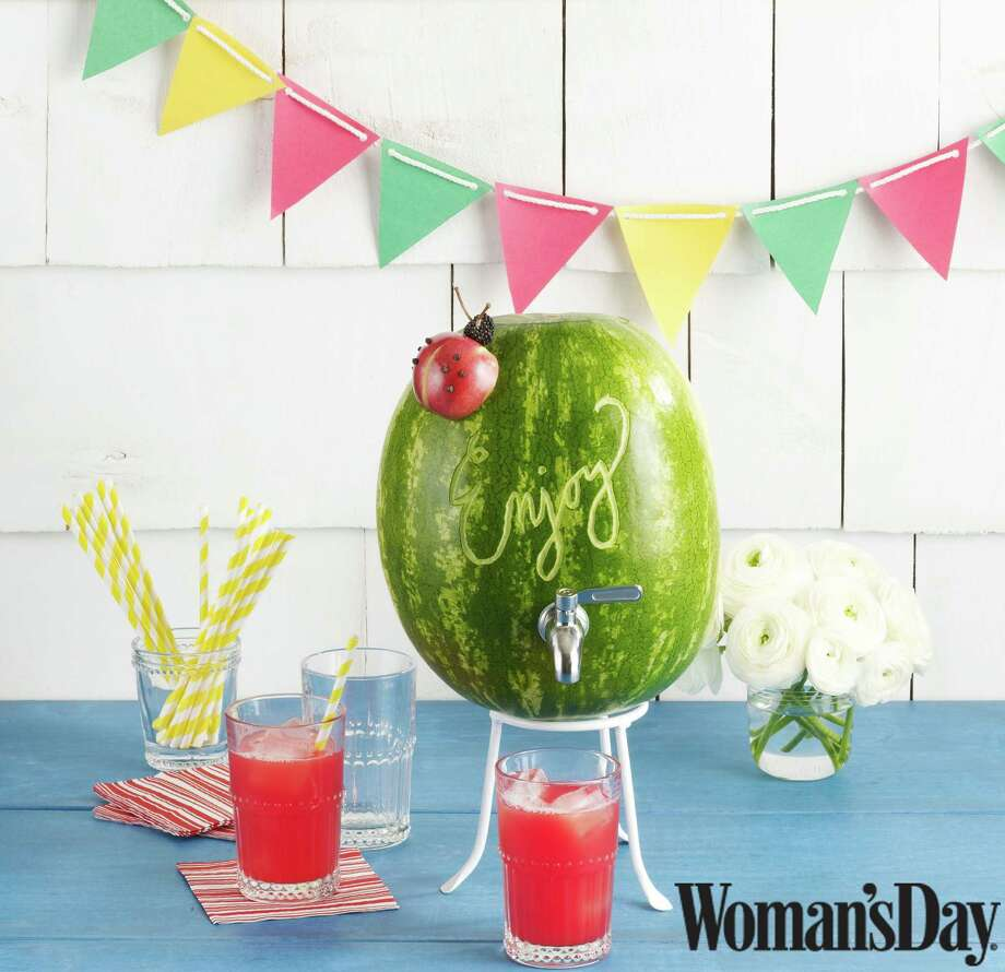 A watermelon can be carved into a festive beverage dispenser. Photo: Woman's Day/Kat Teutsch / ONLINE_YES