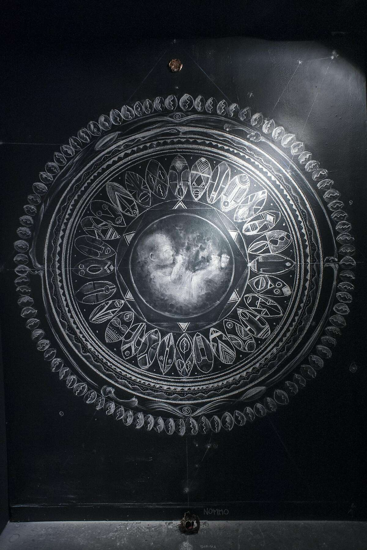 """A chalk drawing by Sage Stargate, one of the many pieces on display at SOMArt's """"Making a Scene"""" exhibition."""