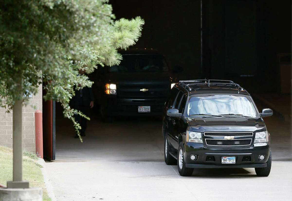 A black SUV carrying Texas Attorney General Ken Paxton and others departs the Collin County jail Monday, Aug. 3, 2015, in Plano, Texas. (AP Photo/Tony Gutierrez)