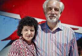 Mitch Kapor and Freada Kapor Klein stand in front of the new home of the Kapor Center for Social Impact that they are renovating in Oakland, Calif., on Wednesday, June 20, 2013.