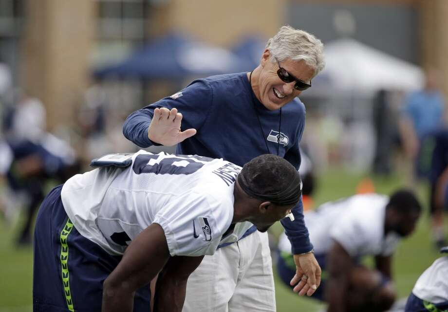 Seattle Seahawks head coach Pete Carroll, right, greets newly acquired player Mohammed Seisay at an NFL football training camp Monday, Aug. 3, 2015, in Renton, Wash. (AP Photo/Elaine Thompson) Photo: AP