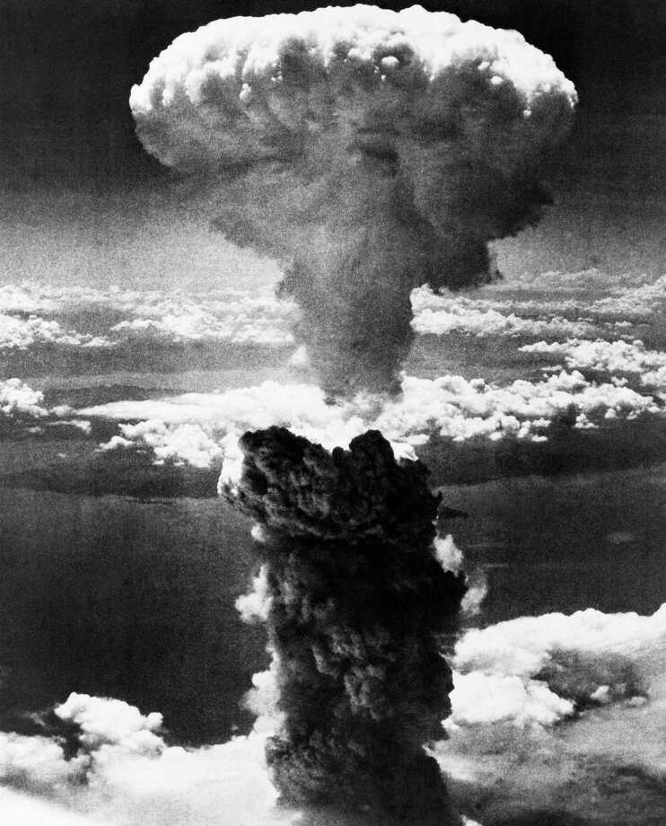 FILE - In this Aug. 9, 1945 file photo, a mushroom cloud rises moments after the atomic bomb was dropped on Nagasaki, southern Japan. On two days in August 1945, U.S. planes dropped two atomic bombs, one on Hiroshima, one on Nagasaki, the first and only time nuclear weapons have been used. Their destructive power was unprecedented, incinerating buildings and people, and leaving lifelong scars on survivors, not just physical but also psychological, and on the cities themselves. Days later, World War II was over. (AP Photo/File) Photo: STF / AP