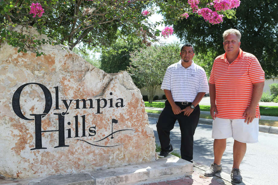 Jeremy Laak (right), superintendent, and Sal Garcia, director of golf, at the entrance to Olympia Hills Golf & Event Center, 1290 Mt. Olympus in Universal City, on July 29, 2015.  MARVIN PFEIFFER/ mpfeiffer@express-news.net Photo: Marvin Pfeiffer, Staff / San Antonio Express-News / Express-News 2015