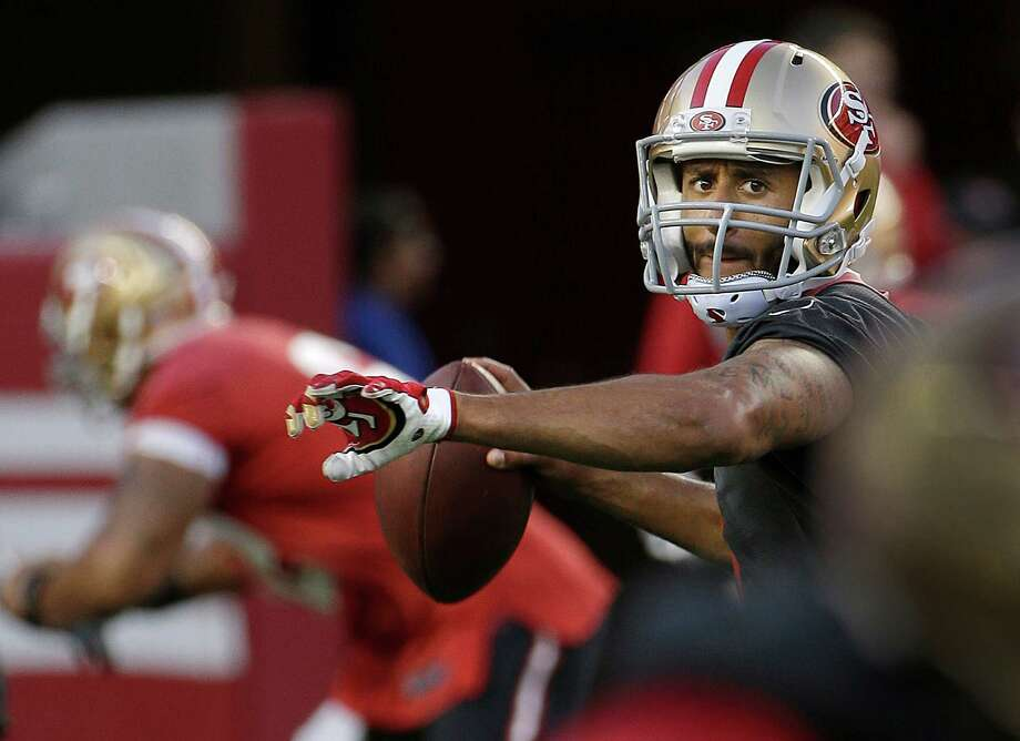 Colin Kaepernick has big-play ability when he scrambles. But that can work against him, leading him to hold the ball too long — he was sacked 52 times in 2014. Photo: Jeff Chiu / Jeff Chiu / Associated Press / AP