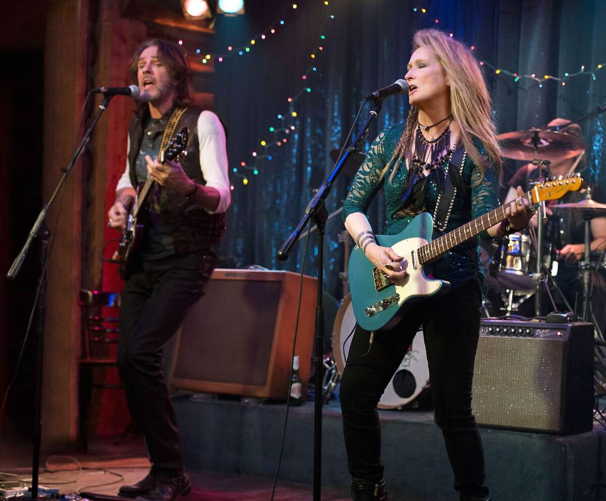 """This photo provided by courtesy of Sony Pictures shows, Rick Springfield, left, as Greg and Meryl Streep, as Ricki, performing at the Flash at the Salt Well in TriStar Pictures' """"Ricki and the Flash."""" The movie opens in U.S. theaters on Aug. 7, 2015. (Bob Vergara/Sony Pictures via AP)"""