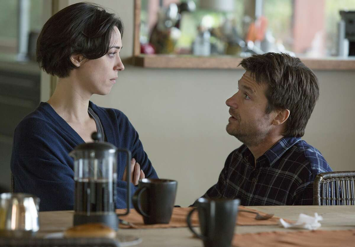 This photo provided by STX Productions LLC shows, Rebecca Hall, left, and Jason Bateman, in a scene from the film,