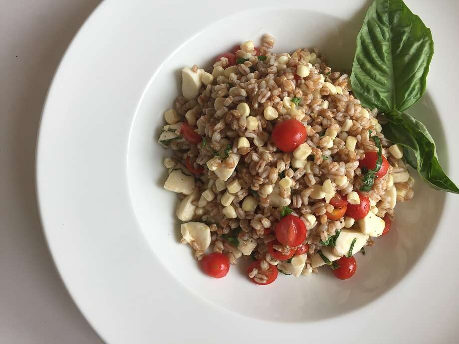 Summer farro salad with tomatoes, basil, corn and mozzarella Photo: Amanda Gold