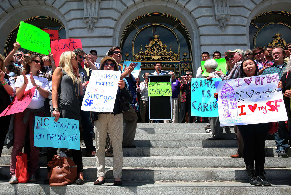 A measure on the November ballot seeks greater openness behind advocacy efforts, such as this rally outside San Francisco's City Hall last month supporting casual rentals of private homes.
