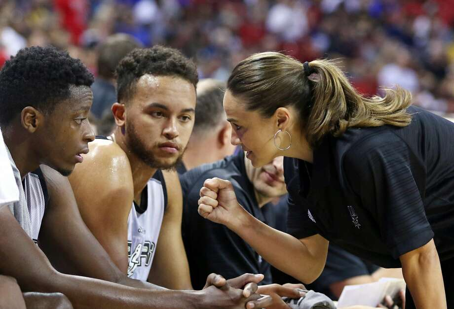 FILE - In this July 11, 2015, file photo, NBA Summer League head coach Becky Hammon talks with San Antonio Spurs' Kyle Anderson, left, and Cady Lalanne during an NBA summer league basketball game against the New York Knicks in Las Vegas. Becky Hammon dreamed of playing in the NBA when she was young. She never got a chance to make that happen. Now though, she's giving girls hope of a chance to coach in the NBA. (AP Photo/Ronda Churchill, File) Photo: Ronda Churchill, Associated Press