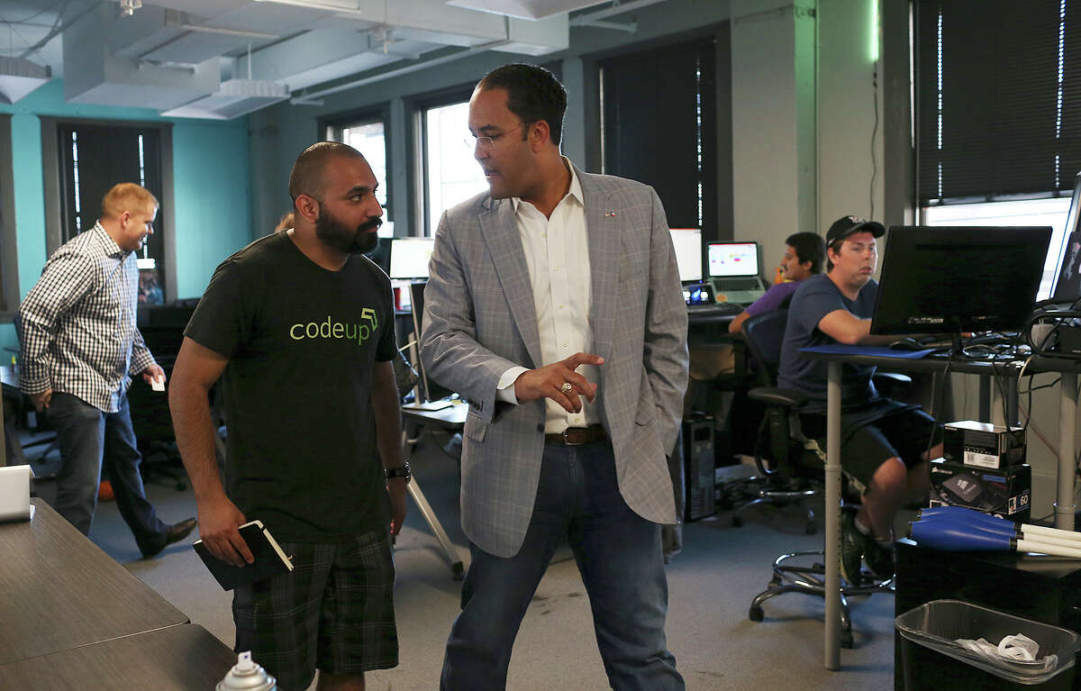 Geekdom director Lorenzo Gomez (left) shows U.S. Rep. Will Hurd, R-Helotes, some of the member tech companies, including WP Engine, a WordPress hosting company. Hurd was visiting with the tech community for input Monday.