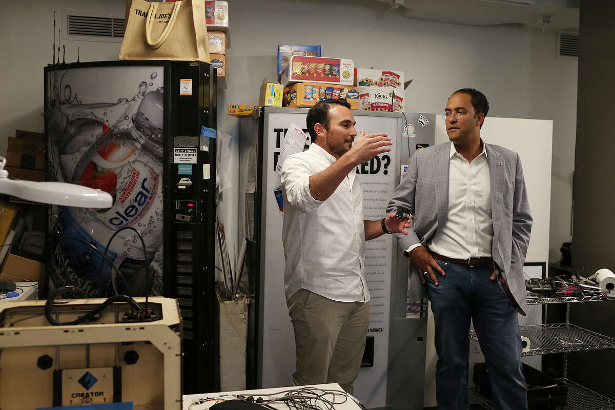 U.S. Representative Will Hurd, R-Helotes, talks with Luis Pablo Gonzalez, founder and CEO of Parlevel Systems, which offers technology for wireless monitoring of vending machines, during a tour of Geekdom at the Rand Building. The Rand Building that houses Geekdom is approaching full capacity.