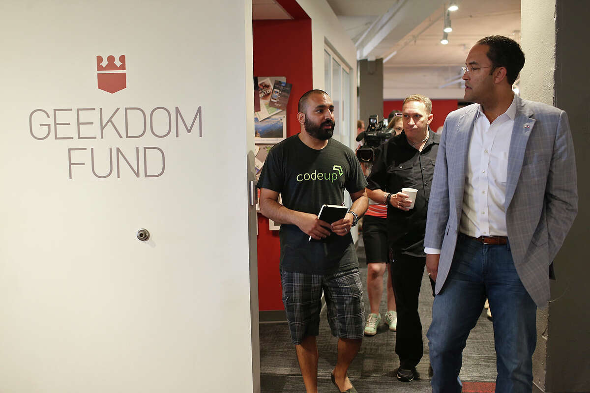 Geekdom director Lorenzo Gomez (from left) and co-founder Nick Longo show U.S. Rep. Will Hurd their facilities in the Rand Building. Hurd, chairman of the subcommittee on information technology, was visiting with the tech community for input.