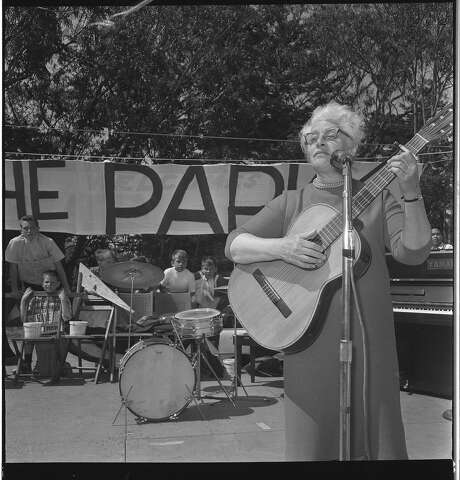 "Malvina Reynolds sings her song, ""The Cement Octopus"" at the anit-freeway rally in Golden Gate Park Photos shot 05/17/1964 Photo: The Chronicle"