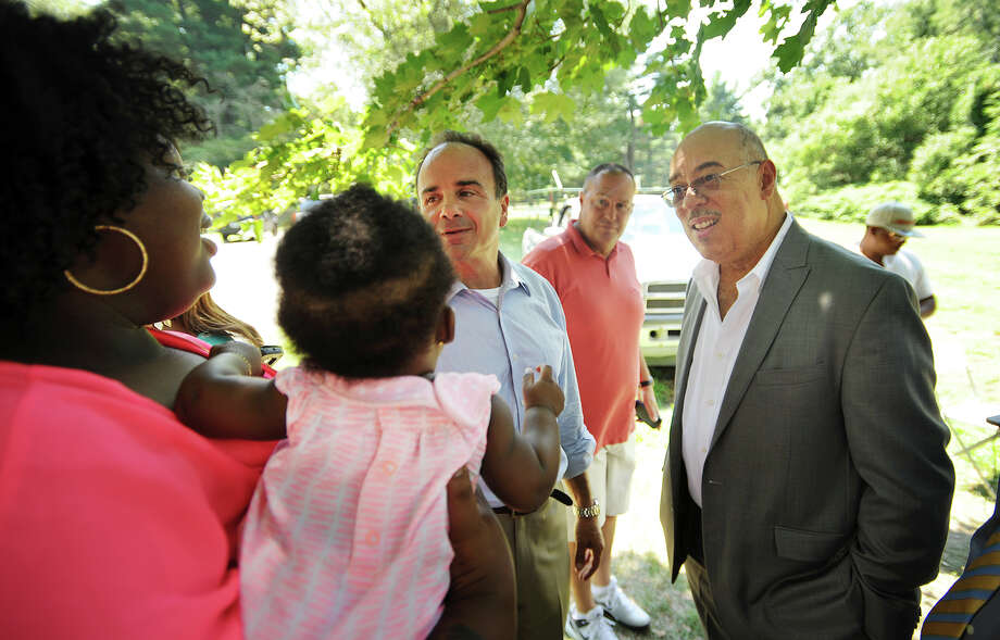 From left; Jhataea Gates, of Bridgeport, talks with mayoral candidate Joseph Ganim and former Bridgeport Police Chief Wilbur Chapman at Beardsley Park. Photo: Brian A. Pounds / Hearst Connecticut Media / Connecticut Post