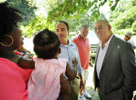 From left; Jhataea Gates, of Bridgeport, talks with former Bridgeport mayor and current mayoral candidate Joseph Ganim and former Bridgeport Police Chief Wilbur Chapman at Beardsley Park in Bridgeport, Conn. on Monday, August 3, 2015. Chapman spent the day travelling with Ganim on the campaign trail to a variety of sites and events around the city. Gates holds her baby, Amore Robinson, 5 months.