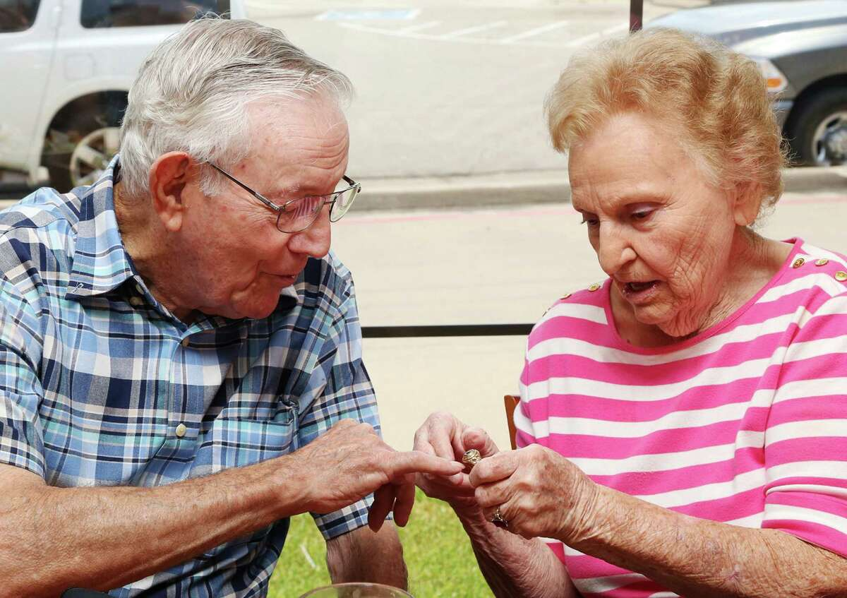 Jeanette Gooch Green, 90, returns a service ring to Robert Storey Jr., 95, on Thursday during a reunion after 70 years of mostly not seeing each other. They met on a blind date in 1944.