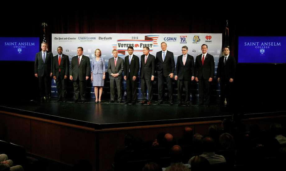 Republican presidential candidates gather on stage before a forum  Monday, Aug. 3, 2015, in Manchester, N.H. From left: Jeb Bush, Ben Carson, Chris Christie, Carly Fiorina, Lindsey Graham, Bobby Jindal, John Kasich, George Pataki, Rick Perry, Rick Santorum, and Scott Walker. (AP Photo/Bill Sikes) Photo: Bill Sikes, STF / AP