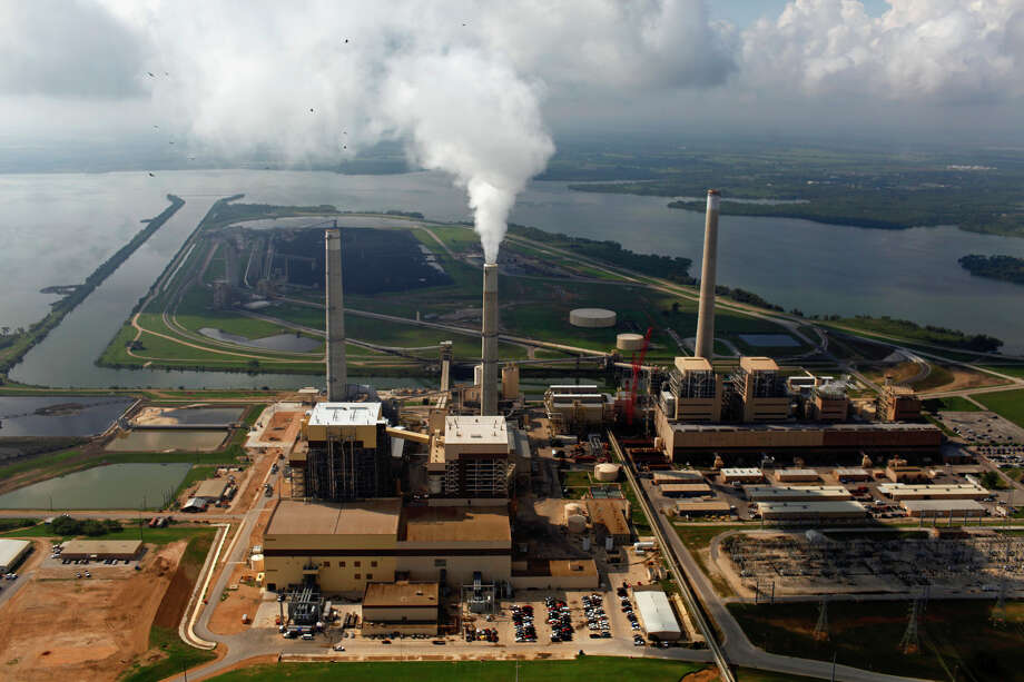 CPS Energy's coal plants Spruce 2 (from left), Spruce 1 and Deely are seen on Calaveras Lake. CPS opted to close Deely, the oldest coal-fired plant, ahead of schedule in 2018. Photo: Express-News File Photo / SAN ANTONIO EXPRESS-NEWS