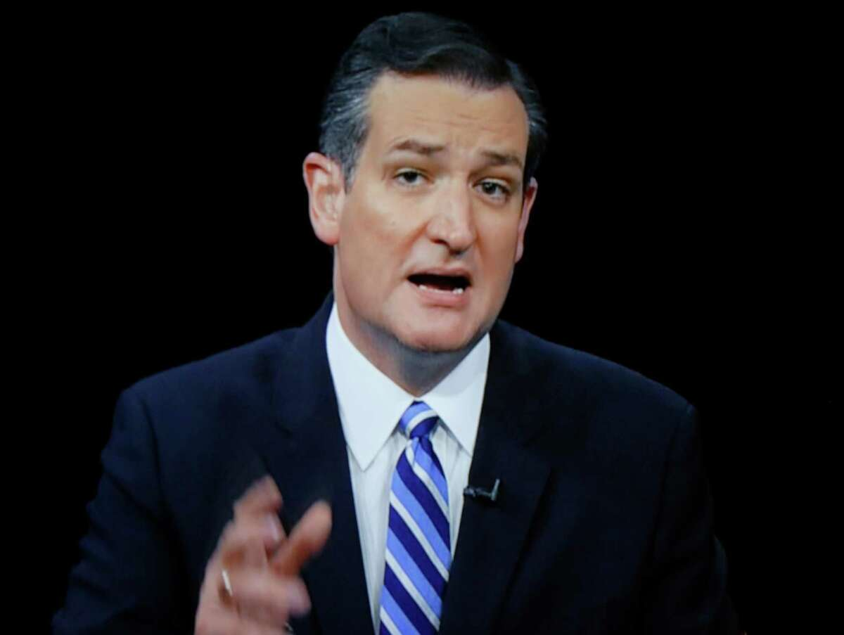 Republican presidential candidate Sen. Ted Cruz of Texas didn't wear a suit at the Central Iowa Impact Gun Range to cook bacon. Video of the stunt is on YouTube.