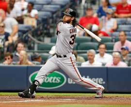 ATLANTA, GA - AUGUST 03:  Brandon Crawford #35 of the San Francisco Giants hits a solo home run in the second inning during the game against the Atlanta Braves at Turner Field on August 3, 2015 in Atlanta, Georgia.  (Photo by Mike Zarrilli/Getty Images)